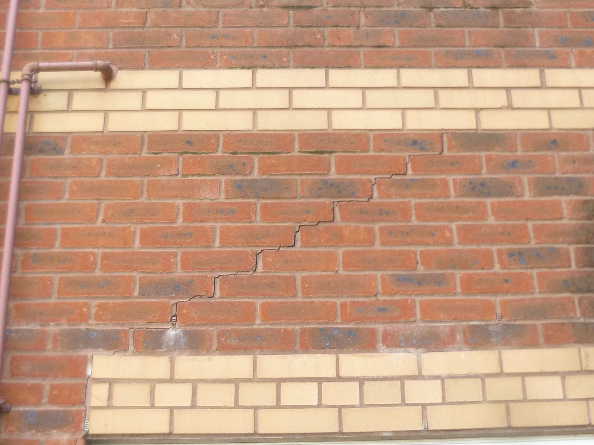 Diagonal Stepped Cracking to Residential Apartment Block - Helifix Helibars later used for repairs.