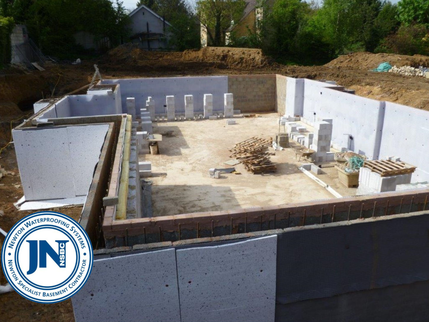 Newton System 500 Membrane to Interior Walls and Newton System 400 Geodrain to Exterior Walls