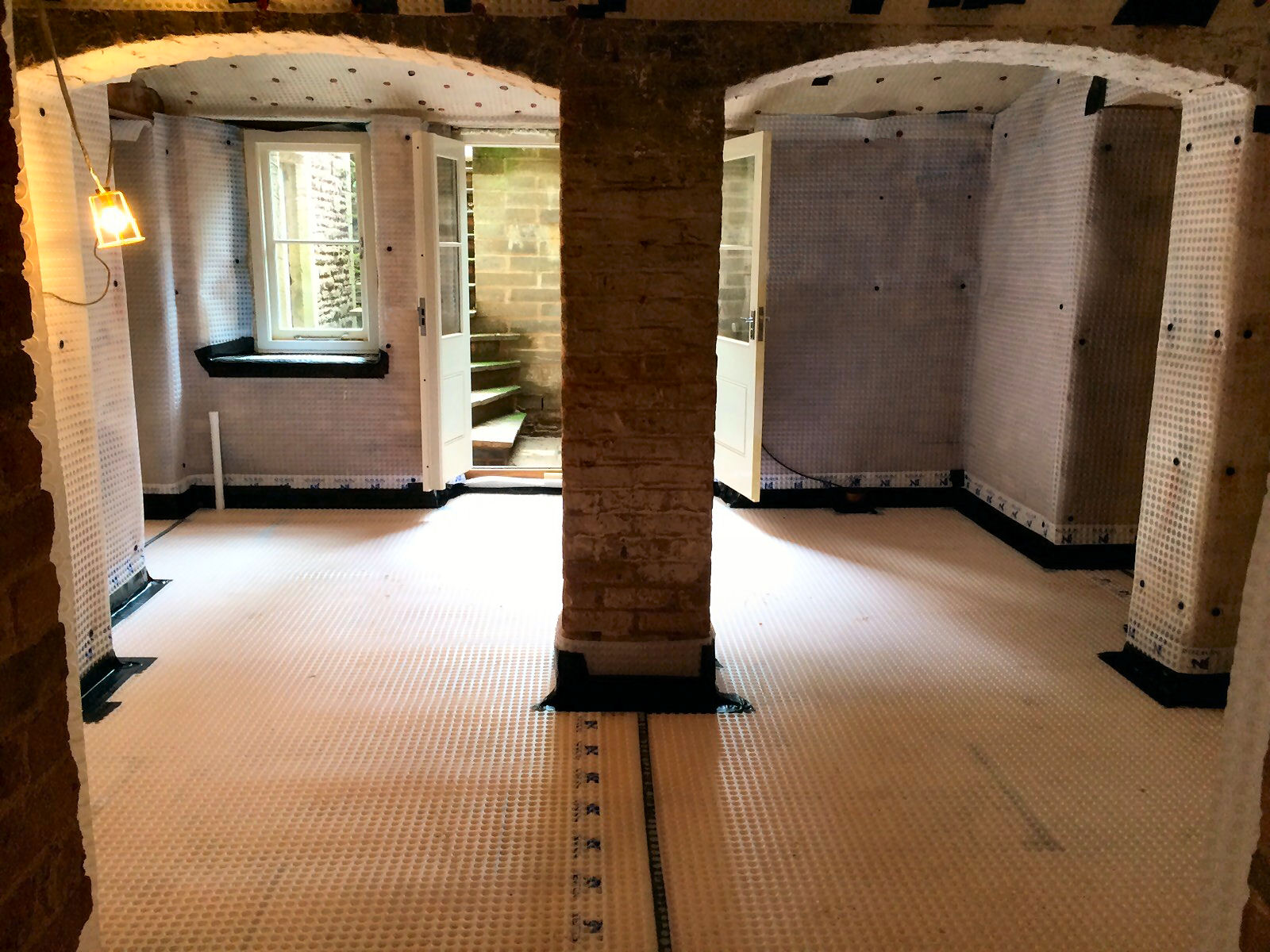 Type C (Drained) Waterproofing Installation Underway using Cavity Drain Membrane to vaulted Basement Conversion.