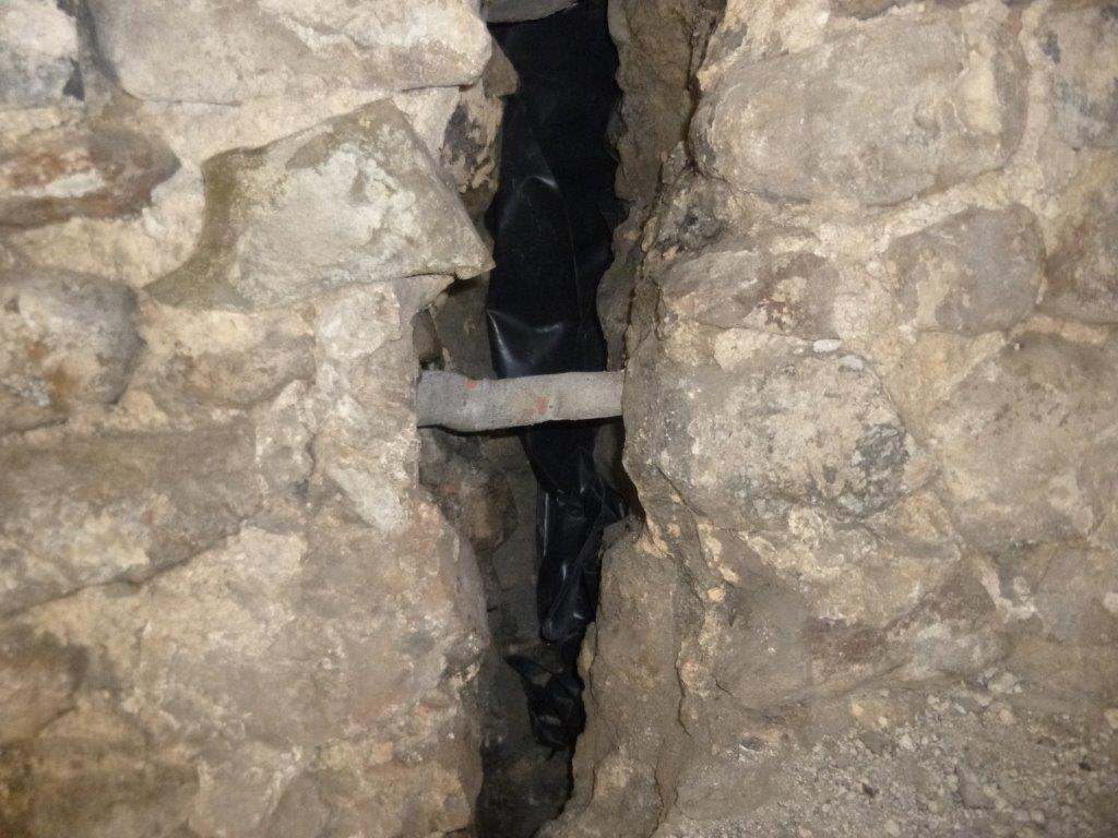 Cintec Consolidation Anchor installed to fractured stone wall. Crack to be later grouted.