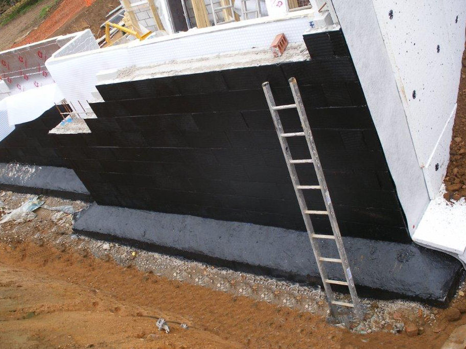 Type A (Barrier Protection) Liquid Membrane applied with Type C (Drained Protection) Internal and External Membrane installation underway.