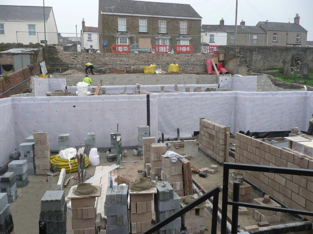 Cavity Drain Membrane (Type C Protection) installed to Earth Retaining Walls of New Build Project on a Sloping Site.