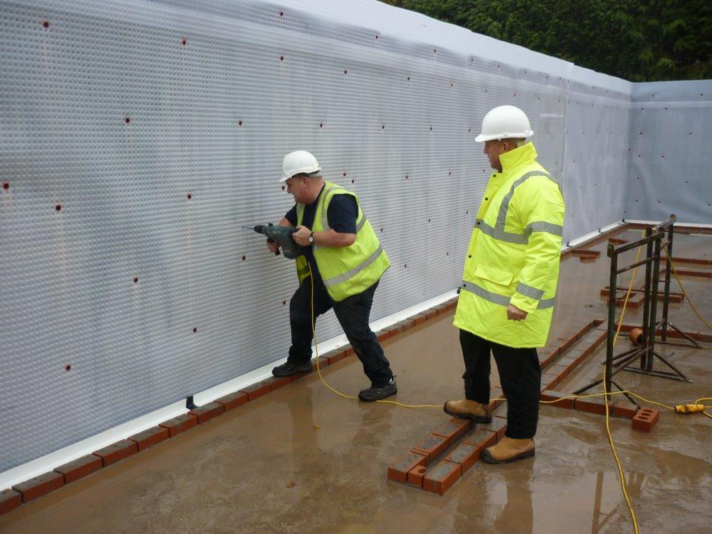 Protectahome Surveyor and Technician on site during Type C Cavity Drain Membrane Installation to New Build Project.