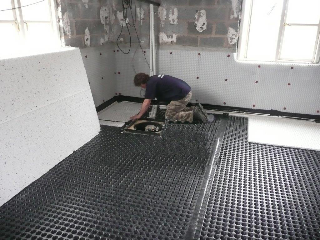 Protectahome Technician Installing Cavity Drain Membrane and Sump and Pump System