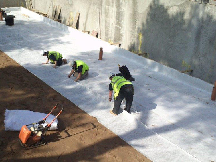 Protectahome Technicians Installing Pre Applied Waterproofing System using Newton Hydrobond (Type A Barrier Protection).