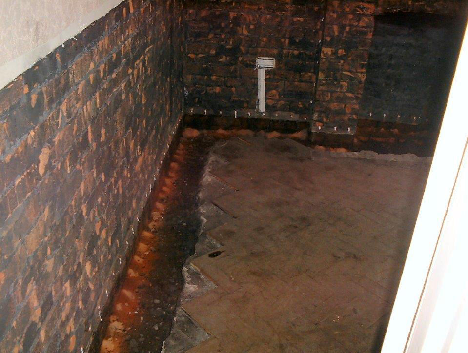 White Dots Show Completed Damp Proof Course Injection