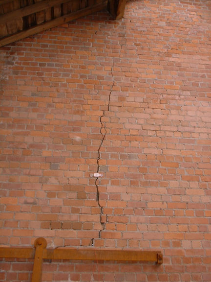 Protectahome - Cracked Brick Wall ©