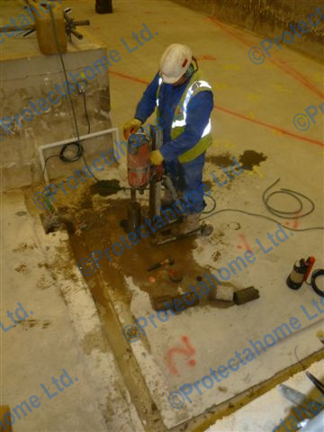 Drainage Channel being cut into slab as preparation for waterproofing installation to begin
