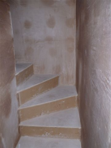 Basement stairwell waterproofed and plastered