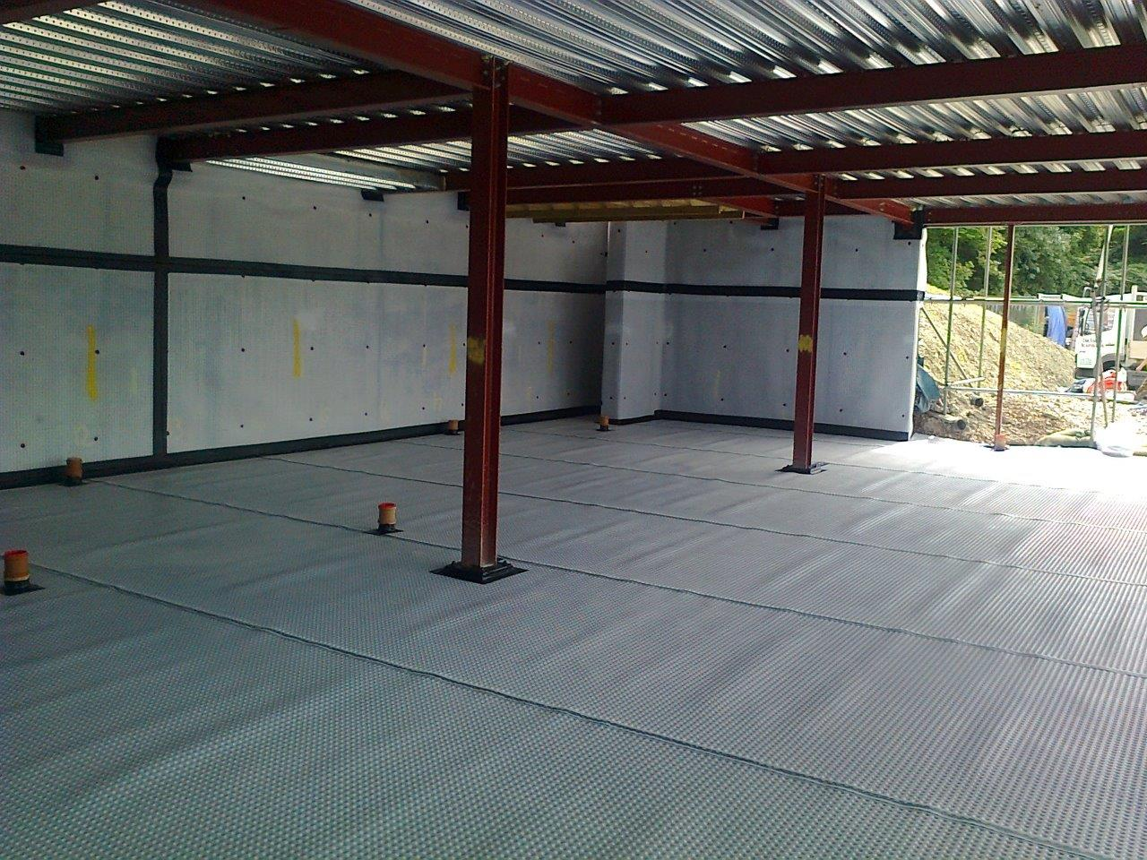 DURING: Cavity Drain Membrane Installed to Earth Retaining Elevations and Floor