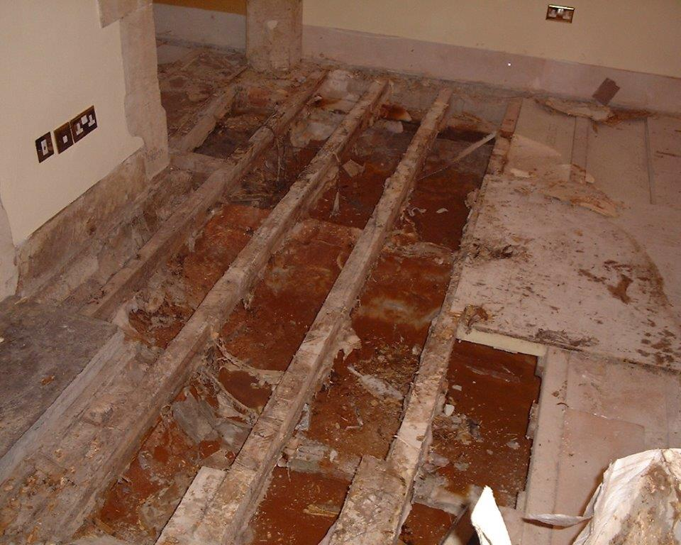 Severe Dry Rot timber attack beneath floorboards